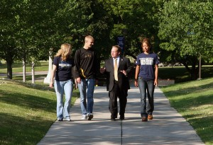 President Davies walking with students