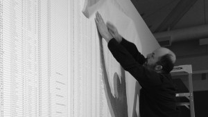 Ian Boyden installing the Names of the Student Earthquake Victims Found by the Citizens' Investigation (2008-2011) by Ai Weiwei. Photograph by Patricia Bolding.