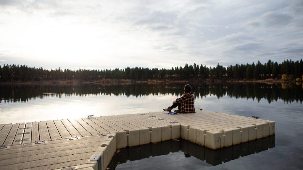 EOU English Student Sitting on Morgan Lake Dock