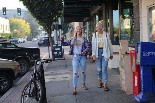 girls walking down the sidewalk in La Grande