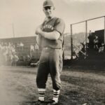 EOU Alumni Denver Ginsey poses at a baseball game