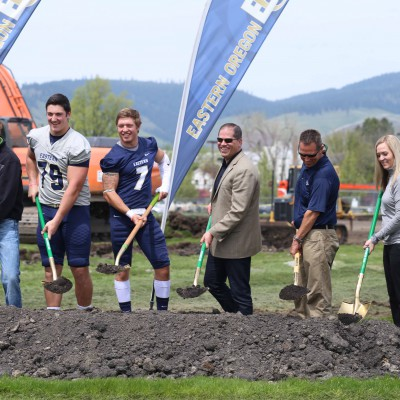 Ceremonial dirt scoop at Stadium-Track ground-breaking