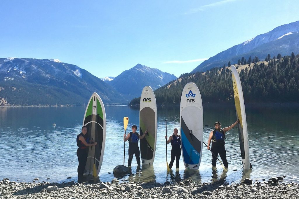 Students paddleboarding at Wallowa Lake with the EOU Outdoor Adventure Program