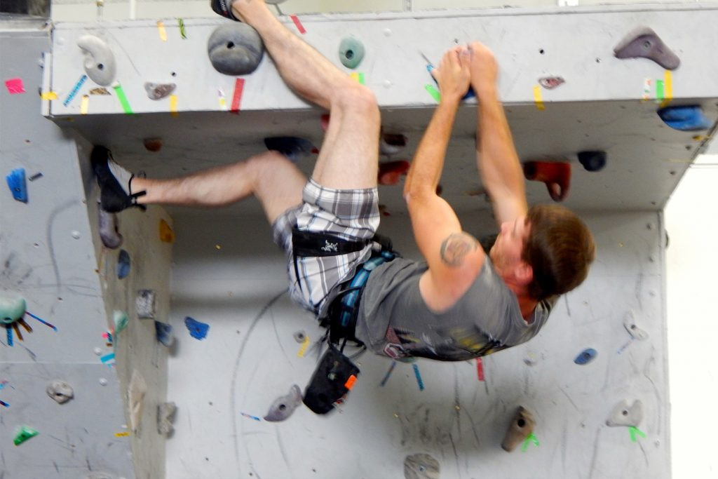 Student rock climing in the EOU Bouldering Gym