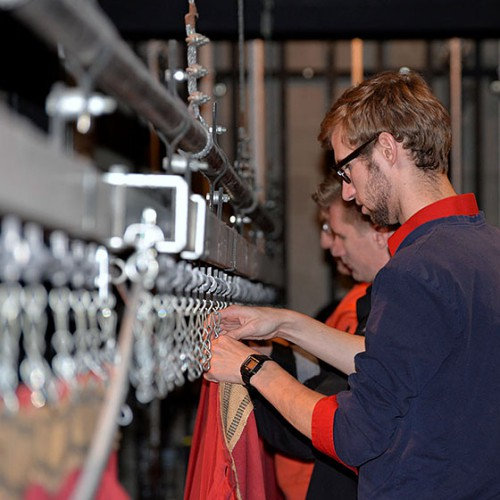 Photos by Berenice Chaves / EOU student Sam Shown, foreground, assists with the installation of new curtains in McKenzie Theatre in Loso Hall. The drapes were purchased with a $17,000 donation from the Oregon Agriculture Foundation established by Glen and Jean McKenzie.