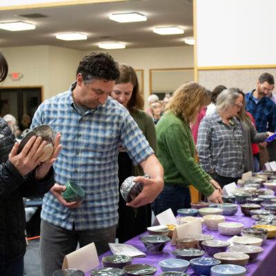 People Selecting Bowls at the Shelter From the Storm Soup Supper 2020