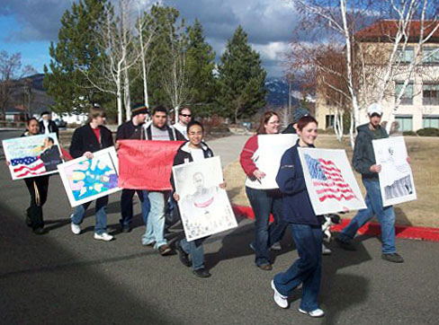 EOU file photo / Students participate in the annual MLK, Jr. Day march. The event begins at 11 a.m. Monday at Max Square and ends back on campus.