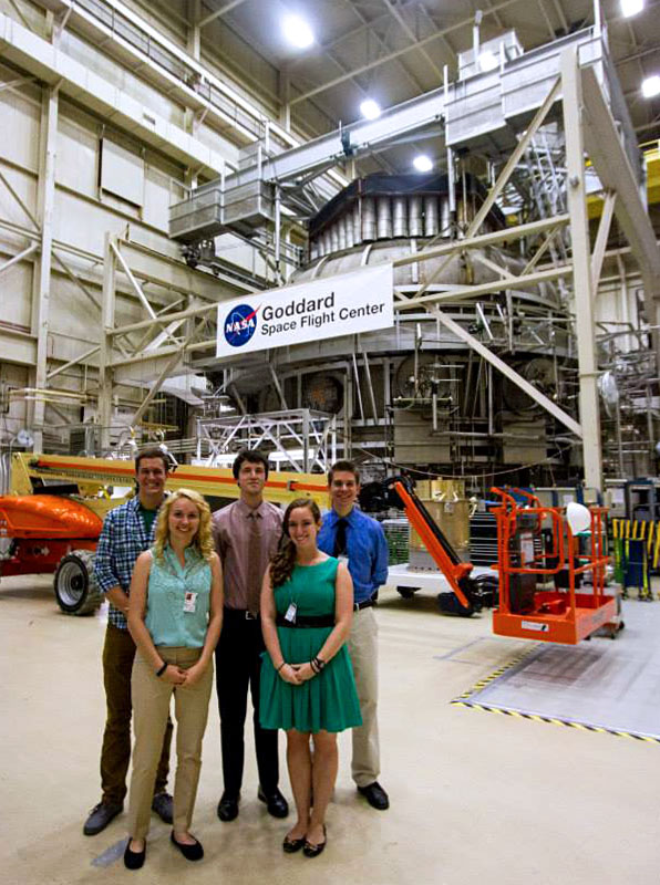 Nyki Anderson stands in front of the second biggest vacuum chamber in the country.