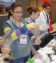 Members of EOU's student chapter give a chemistry demonstration during the national meeting of the American Chemical Society in Dallas, Texas last year.