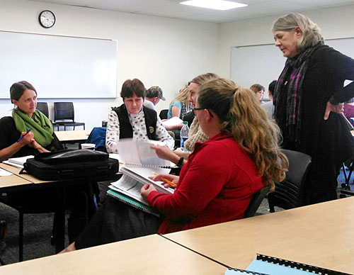 Photo by Katie Butterfield / Area educators learn more about implementation of the Next Generation Science Standards from Leslie Graham, right, during a recent seminar hosted by GO-STEM at EOU.