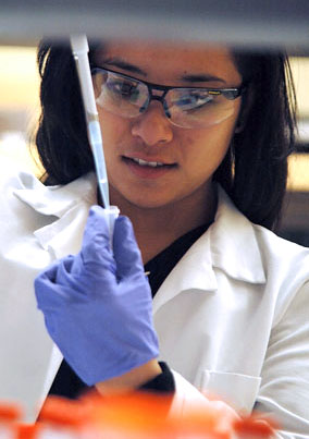 In the lab at EOU, Keohokalole-Look prepares a polymerase chain reaction sample for DNA amplification.