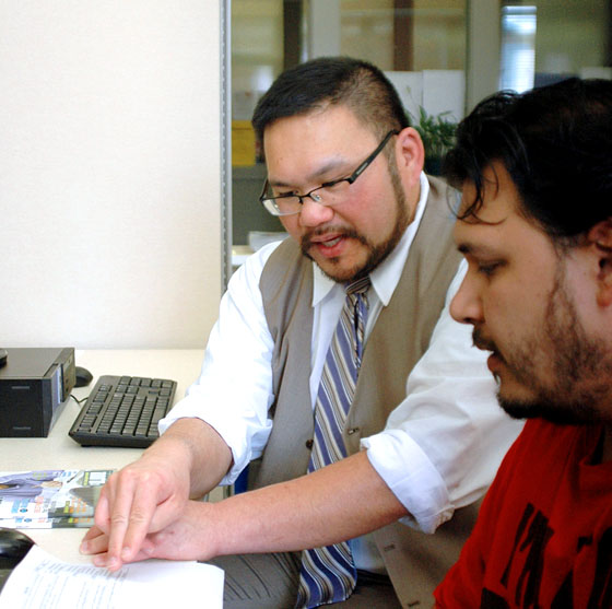 Justin Chin, director of Career Services, shares information on a job lead with EOU student Matt Muritok.