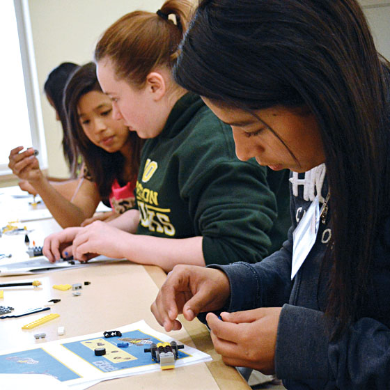 Photo by Kaitlin Cassidy / Students built Lego helicopters as one of many activities during the SMILE workshop at EOU last year.
