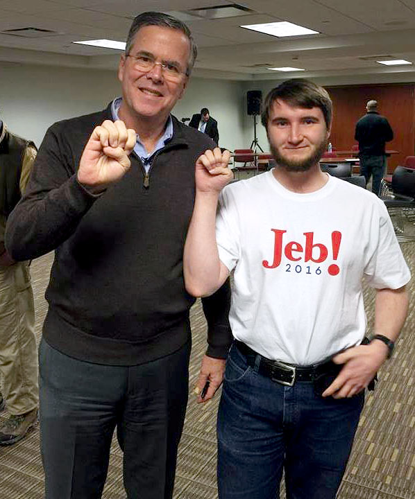 "Alex McHaddad and Jeb Bush sign the letter ""E"" for Eastern Oregon University. McHaddad, a senior at EOU, met Bush in Iowa last month while he was there volunteering for Mission: NEXT."