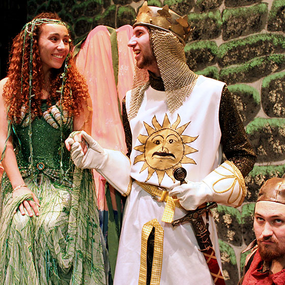 """Shahayla Ononaiye is the Lady of the Lake, Sam Shown is King Arthur and Griffin Fleming is Patsy in EOU's production of """"Spamalot."""""""