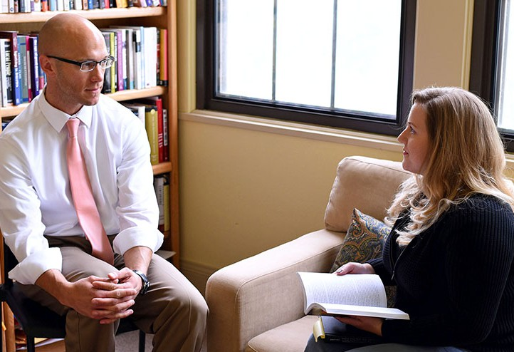 Photo by Laura Hancock / Ryan Dearinger, associate professor of history, visits with Gray-Jeffries in his office in Ackerman Hall.