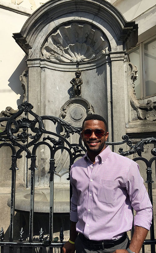 Submitted photo / Miles Loupé at the Manneken-Pis fountain in Brussels, where he met up with four Millennial Community counterparts to present a discussion at a conference on the impact millennials are making on businesses worldwide.