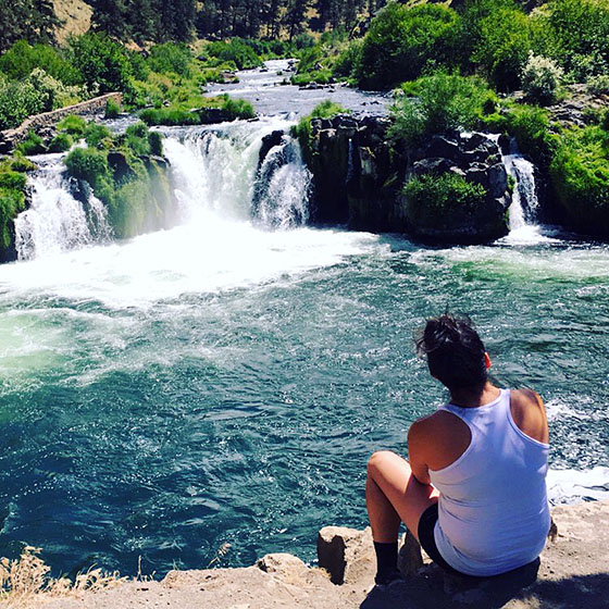Photo by Natalie Sanchez / EOU student Ana Badillo-Juarez enjoys the view of Steelhead Falls on the Deschutes River. Badillo-Juarez is the first recipient of a new award intended to help supplement costs associated with many outdoor activities.