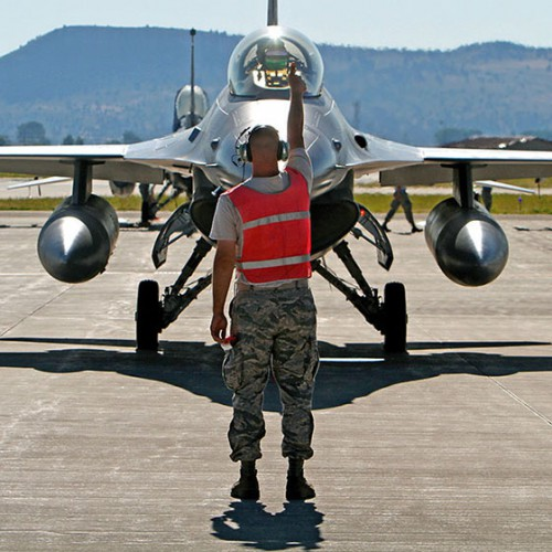 "Photo by Andrew Mariman / An F-16 pilot gets the ""thumbs up"" prior to an early morning training run. More students enlisting in the air force will have access to earn a bachelor's of applied science degree from Eastern Oregon University thanks to a new partnership with Klamath Community College."