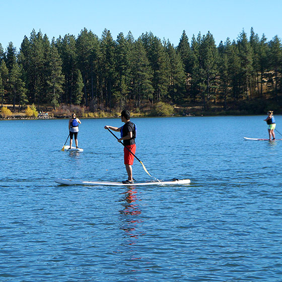 EOU file photo / Students participating in Summer Bridge will attend academic workshops and have the opportunity to try a new activity, like stand-up paddle boarding at Morgan Lake.