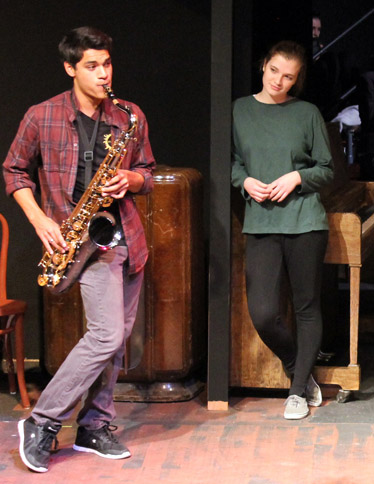 Theatre major Miguel Vasquez, of Hood River, serenades Heidi Gerlach, who is cast as Hetty Oak, founder of the all-female British acting troupe. Vasquez portrays Joseph Rosenbaum, the son of another actress in the group. Gerlach is from Eugene and is also majoring in theatre at EOU.