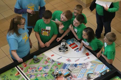 EOU Computer Science student Taylor Hunt volunteering at Lego Robotics tournament