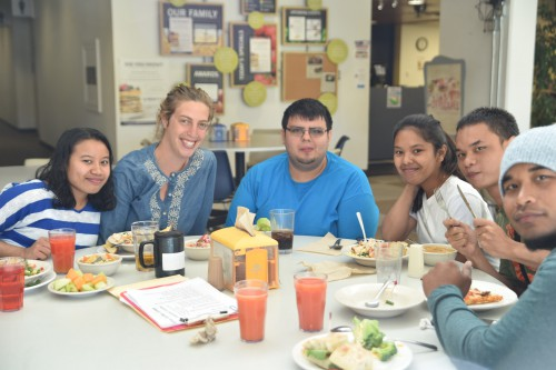 Incoming EOU students enjoy lunch in the cafeteria during Summer Bridge. Sarah Fischer, second from left, is a program specialist for TRIO Student Support Services.