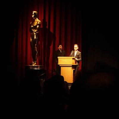 Skye speaking beside the Oscar statue