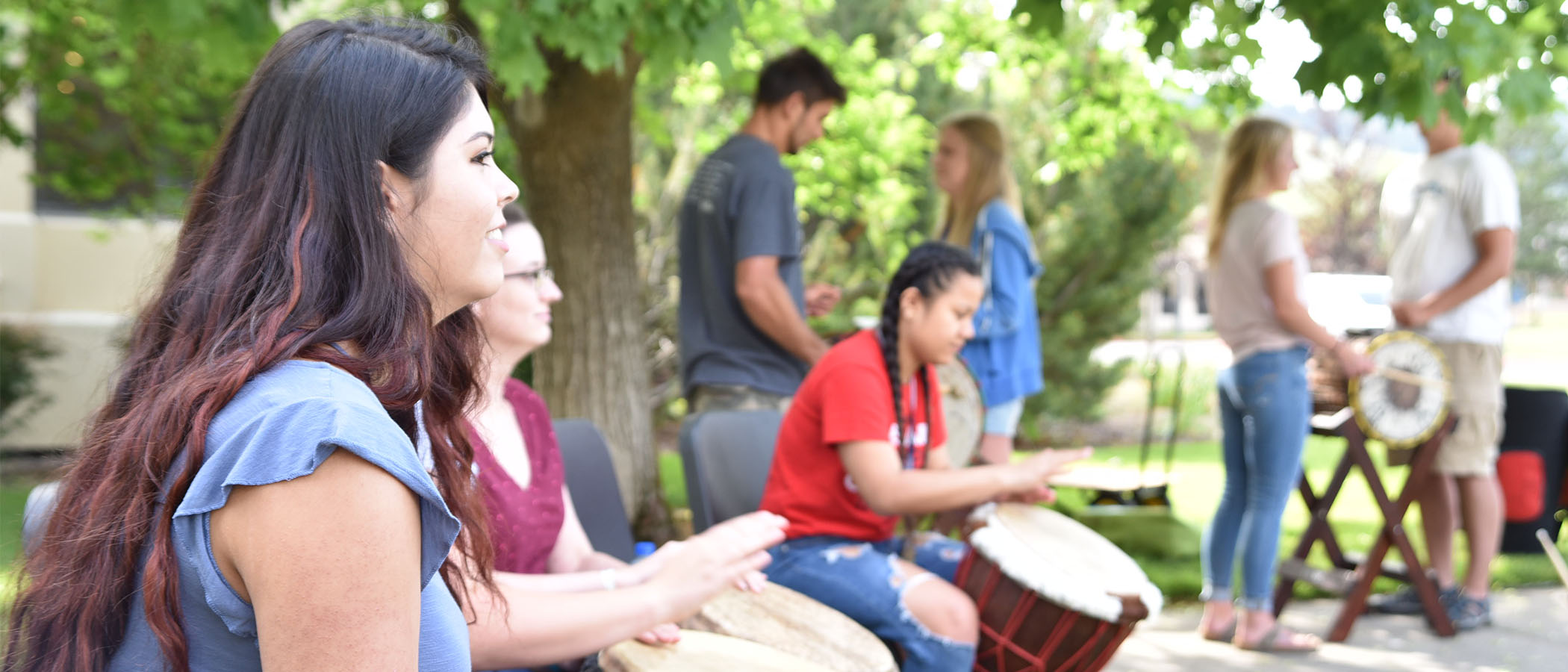 Students making music in the quad