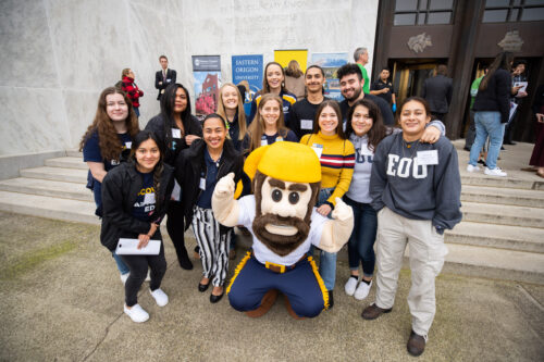 EOU students and mascot pose in front of the state capitol on University Day 2020