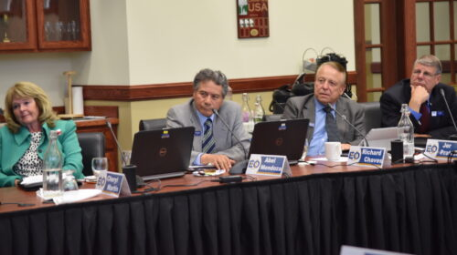 Board of Trustees listen during a meeting