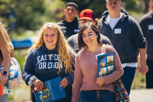 Two prospective students laugh during a campus tour