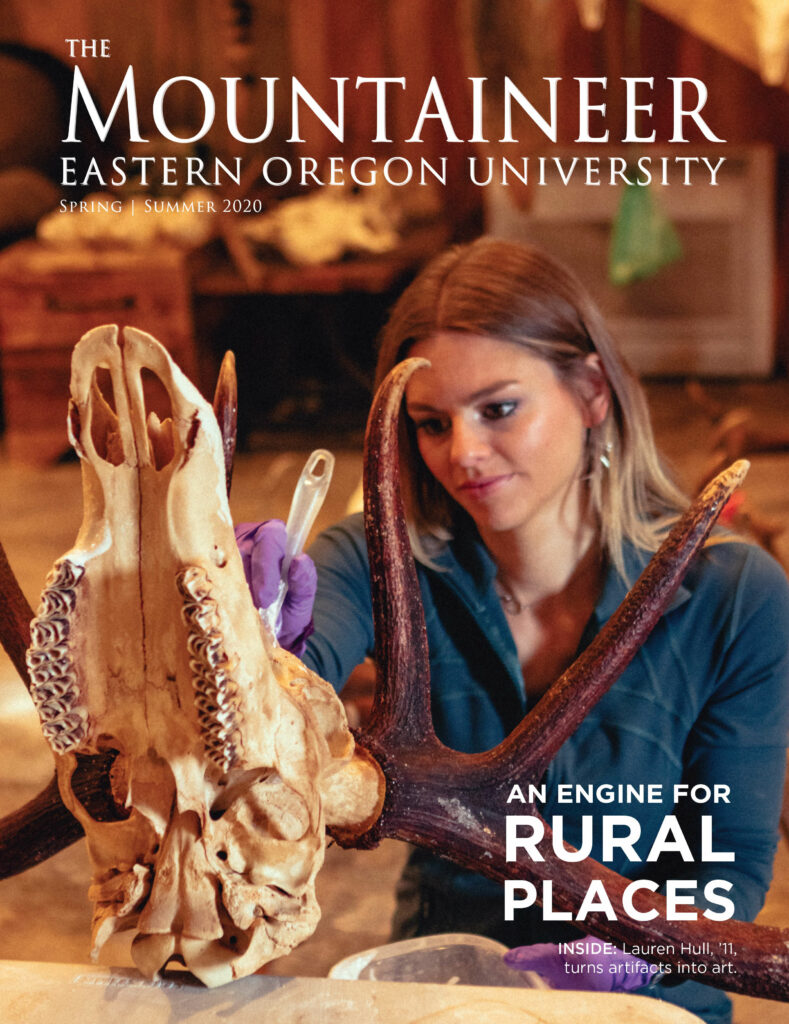 The cover of the mountaineer magazine with a woman creating art our of an elk skull.