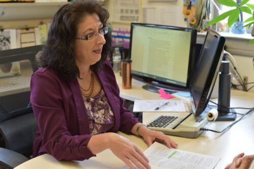Picture of EOU Financial aid director Sandy Henry in her office