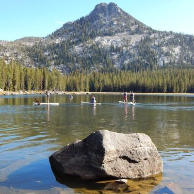 Picture of eou students paddleboarding on an alpine lake