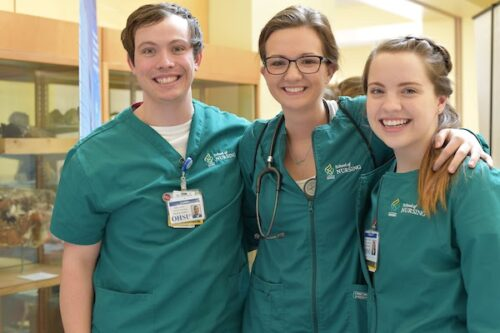 three nursing students in scrubs