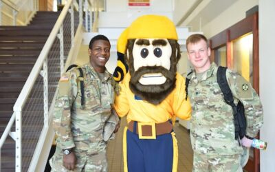 Monty mascot with ROTC students