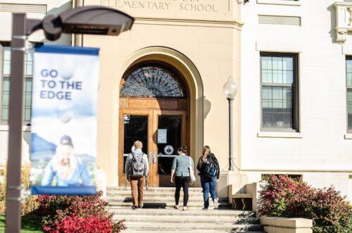 students walk into Ackerman Hall