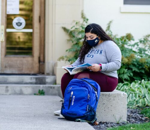 Ximena reading on campus