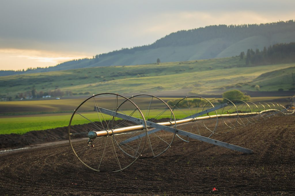 pivot irrigation in front of mountains