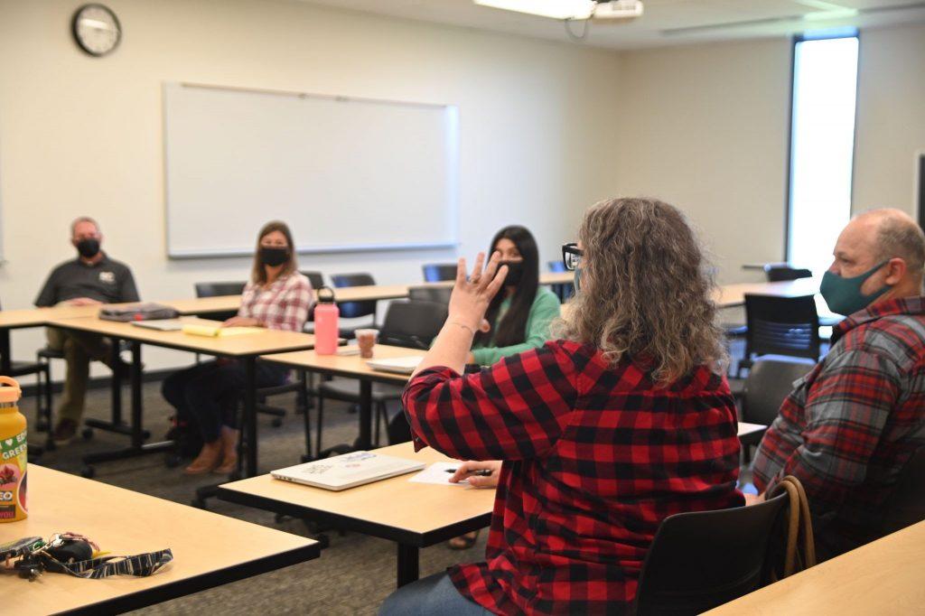 Screenwriter Sarah Greenman leads a script development meeting for the Urban-Rural Theatre Project.